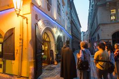 Street corner under glow of lamp and entrance to restaurant. PRAGUE, CZECH REPUBLIC,- 29 AUGUST 29, 2017; Street corner under glow of lamp and entrance to Royalty Free Stock Images