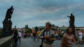 PRAGUE, CZECH REPUBLIC - August 23, 2016: Time-lapse video of Charles bridge and Prague castle during sunset hidden stock video footage