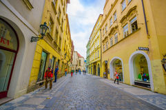 Prague, Czech Republic - 13 August, 2015: Very nice tight street around old town, bridgestone road and beautiful yellow Royalty Free Stock Image