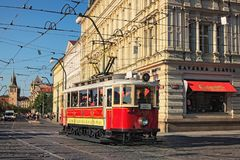 Vintage red tram at street in historical city center as symbol of Prague Royalty Free Stock Images