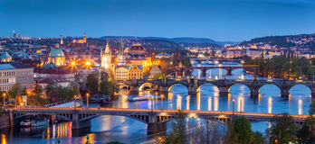 Prague, Czech Republic bridges panorama. Charles Bridge and Vltava river at night Stock Images