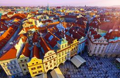 Prague, Czech Republic. Central square. Staromestska. Coloured houses among residential quarters of city. Aisles of buildings with red tegular tiling roofs stock photo