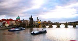 Charles Bridge over Vltava river in Prague, Czech Republic during the evening stock footage