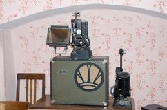 Antique cinema projection equipment in antique room Royalty Free Stock Photography