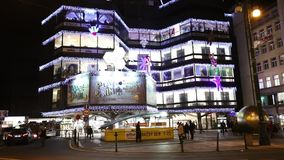 Christmas markets in front of a large decorated shopping center Kotva in Prague on the Republic square. stock video footage