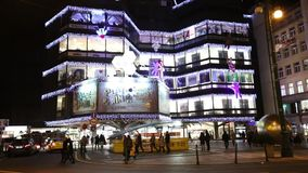 Christmas markets in front of a large decorated shopping center Kotva in Prague on the Republic square. stock video