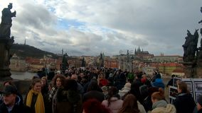 Charles Bridge with crowd of tourist stock video