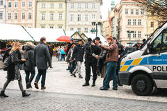 Prague, Czech Republic - December 25, 2016: Czech policemen on a Christmas day help the tourist - show the desired place. Of attractions on the map. Respectful Stock Photo