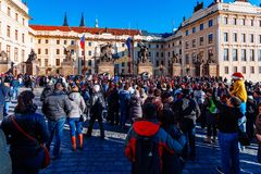PRAGUE, CZECH REPUBLIC - DECEMBER 23, 2015 : Czechia people and foreigner travelers waiting for the Changing The Guard at gate fro Royalty Free Stock Photography