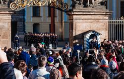 PRAGUE, CZECH REPUBLIC - DECEMBER 23, 2015 : Czechia people and foreigner travelers waiting for the Changing The Guard Royalty Free Stock Photo