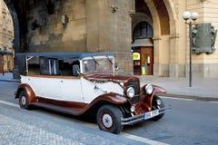 Famous historic red car Praga in Prague street. PRAGUE, CZECH REPUBLIC - DECEMBER 9, 2017: Famous historic car Praga at street in advent christmas time. Praga is Royalty Free Stock Photos