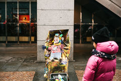 Prague, Czech Republic, December 24, 2016 - A funny clown an adult is disguised as a child in a stroller . Entertainment Stock Image