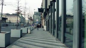 PRAGUE, CZECH REPUBLIC - DECEMBER 3, 2016. 4K steadicam shot of modern stores with big glass showcases stock video