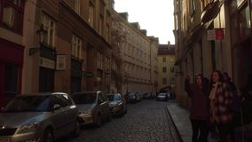 PRAGUE, CZECH REPUBLIC - DECEMBER 3, 2016. Local teenagers on the street of Old town. 4K steadicam video stock footage