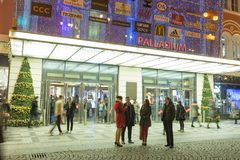 People coming in and out from the large decorated shopping center Palladium in Prague on the Republic square. PRAGUE, CZECH REPUBLIC - DECEMBER, 13, 2017 Stock Photo