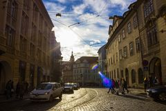 Prague, Czech Republic - December 31, 2017: The people going near houses of old architecture in Old Town. At Prague, Czech Republic - December 31, 2017 Royalty Free Stock Image