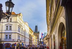 Prague, Czech Republic - December 31, 2017: The people going near houses of old architecture in Old Town. At Prague, Czech Republic - December 31, 2017 Stock Photo