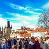 Prague, Czech Republic - December 31, 2017: People walking on the historic Charles Bridge stock images