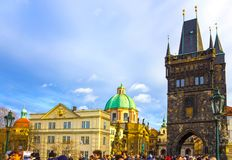 Prague, Czech Republic - December 31, 2017: People walking on the historic Charles Bridge. That crosses the Vltava river overlooking its entrance tower Stock Image