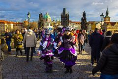 Prague, Czech Republic - December 31, 2017: People walking on the historic Charles Bridge. Prague, Czech Republic - December 31, 2017: People walking in the Stock Images