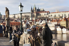 PRAGUE, CZECH REPUBLIC - DECEMBER 23, 2015: Photo of Street musicians on the Charles Bridge. Stock Images