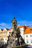 Prague, Czech Republic - December 31, 2017:Prague, Czech Republic: Statue of Vitus on the north side of Charles Bridge royalty free stock photo