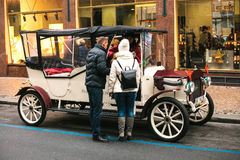 Prague, Czech Republic, December 24, 2016: Retro cars for entertainment tourists during the Christmas holidays in Prague royalty free stock photography