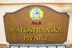 Prague, Czech Republic - December 31, 2017: The street sign at main entrance to Svejk beer pub royalty free stock photo
