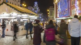 Christmas markets in front of a large decorated shopping center Palladium in Prague on the Republic square, 2017, 4k 3840p stock video footage