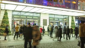 Time lapse video of people coming in and out from the large decorated shopping center Palladium in Prague, 3840, 24fps stock video