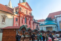 Popular Christmas market in the Prague Castle. PRAGUE, CZECH REPUBLIC - December 13, 2018: Tourists visiting the popular Christmas Market at the Prague Castle royalty free stock photography