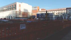 Prague, Czech Republic - December, 2017: Tractors dig pit for the foundation. Building construction stock video footage