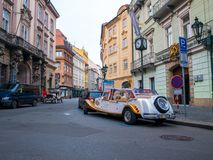 PRAGUE CZECH REPUBLIC - FEB 20 2018: Vintage sightseeing tour car in old town square Prague. On the road stock image