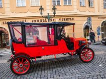 PRAGUE CZECH REPUBLIC - FEB 20 2018: Vintage sightseeing tour car in old town square Prague. On the road royalty free stock photo