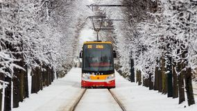 Modern tram in the snowy street of Prague stock photo