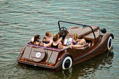 Girls in a paddle boat. Prague, Czech Republic 2018: A group of young girls in a paddle boat - car on river royalty free stock photo