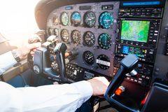 PRAGUE, CZECH REPUBLIC - 9.09.2017: Hand of pilot on handwheel in small plane and dashboard. In sky over Prague Stock Images