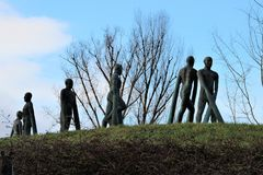 Prague, Czech Republic, January 2015. Stone figures of players against the sky on a hill in a zoo. stock images