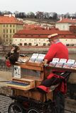 Prague, Czech Republic, January 2013. Street musician on the Charles Bridge in the New Year holidays. stock photo