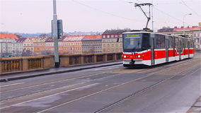 Prague, Czech Republic - January 2016:Tram number 16 moves across the bridge in Prague, Czech Republic. stock video footage