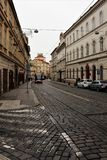 Prague, Czech Republic, January 2015. View of the street in the city center, the historic pavement and modern transport. royalty free stock photography