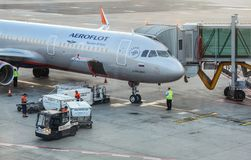 Prague, Czech Republic - July 28th, 2018: Ground personnel loading baggage cargo into Aeroflot Airbus A321 aircraft on Ruzyne, Va. Clav Havel Airport. Flights to stock photos