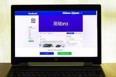 Facebook page of cryptocurrency Libra on notebook screen. PRAGUE, CZECH REPUBLIC - JUNE 19 2019: Facebook page of cryptocurrency Libra on notebook screen on June royalty free stock photos