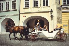 Historical architecture tourists ride horses in carriages. Prague, Czech Republic Royalty Free Stock Photo