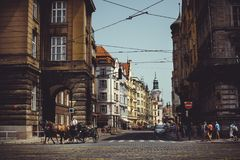 Historical architecture tourists ride horses in carriages. Prague, Czech Republic Stock Images
