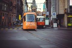Trams on the street in Prague, public transport. PRAGUE, CZECH REPUBLIC - JUNE 2016: Modern streetcar in Prague, public transport Royalty Free Stock Images