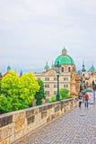 People on Charles Bridge over Vltava River in Prague Church Royalty Free Stock Image