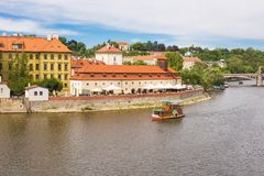 PRAGUE, CZECH REPUBLIC - JUNE 7, 2017: Scenic view on Vltava river and historical center of Prague,buildings and stock photos