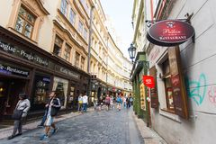PRAGUE, CZECH REPUBLIC - JUNE 7, 2017: Tourists pass by shops and cafes in a picturesque section of Old Town Prague. Prague, Czech Republic - September 25 2016 stock image