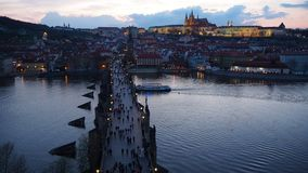 Prague, Czech Republic. Landscape to the Charles Bridge and Vltava river at sunset from the Old Town Bridge Tower stock video footage
